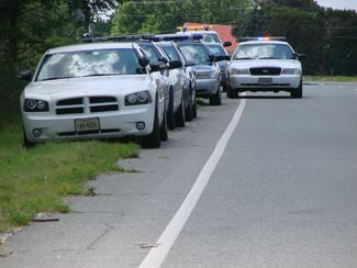 Law Enforcement Vehicles on Side of Road