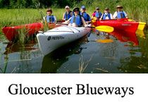 Gloucester Blueways image of four kayaks full of people