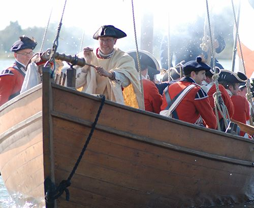 Colonial reenactors in a boat